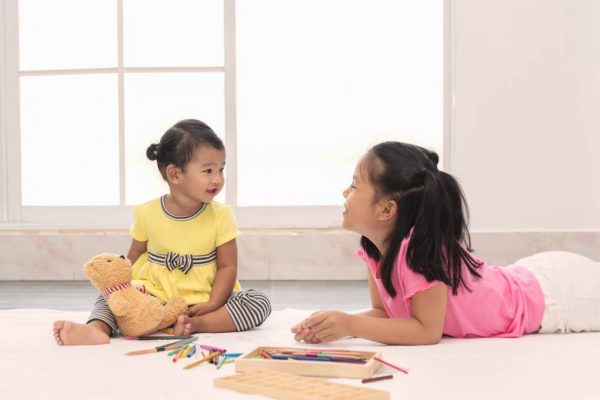How Having a Big Sister Benefits Younger Siblings But at a Cost