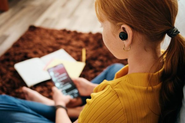 Girl listening to music with earbuds.