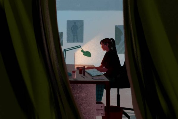 A young student attends online school from her bedroom.